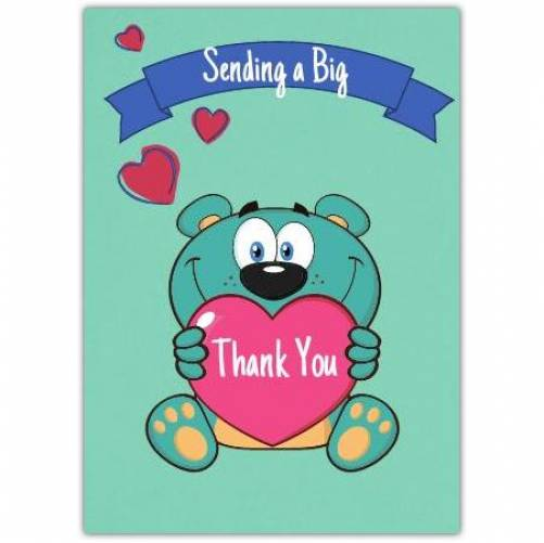 Sending A Big Thank You Holding A Pink Heart Card